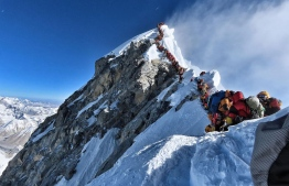 Climbers line up to stand at the summit of Mount Everest in this May 22 photo, released by climber Nirmal Purja's Project Possible expedition. (AFP/Getty Images) (Project Possible/AFP photo)