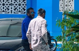Former Vice President Ahmed Adeeb (L) escorted to the Criminal Court by an officer of Maldives Correctional Service.