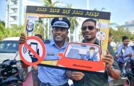 Head of Tourist Police (L) and Minister of Youth, Sports and Community Empowernment Ahmed Mahloof during a road safety awareness campaign. PHOTO: NISHAN ALI / MIHAARU