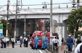 A gerenal view shows multiple police cars, ambulances and fire engines at a crime scene where a man stabbed 19 people, including children in Kawasaki on May 28, 2019. - Two people, including a child, were feared dead in a mass stabbing attack that also injured 17 people in the Japanese city of Kawasaki, the local fire department said. (Photo by Behrouz MEHRI / AFP)