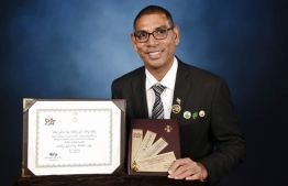 Chef Sobah posing for a picture with the President's Award. PHOTO: SOBAH