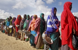 In this Saturday, May 18, 2019 file photo, newly-arrived women who fled drought line up to receive food distributed by local volunteers at a camp for displaced persons in the Daynile neighbourhood on the outskirts of the Somalian capital Mogadishu. PHOTO: AP / Farah Abdi Warsameh