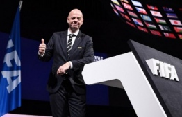 FIFA President Gianni Infantino poses for a picture after being re-elected by acclamation for a second term at the 69th FIFA Congress at Paris Expo, Porte de Versailles in Paris on June 5, 2019. - The 49 year-old, who took charge of FIFA in February 2016 after the departure of the disgraced Sepp Blatter, stood unopposed for re-election for a new four-year term which will run until 2023. (Photo by FRANCK FIFE / AFP)
