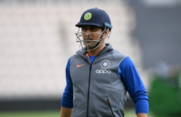 India's Mahendra Singh Dhoni attends a training session at the Rose Bowl in Southampton, southern England, on June 3, 2019 ahead of their 2019 Cricket World Cup match against South Africa. (Photo by Dibyangshu SARKAR / AFP) /
