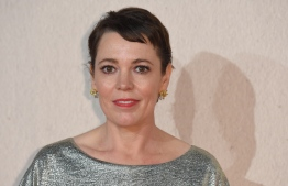 """(FILES) In this file photo taken on October 18, 2018 British actor Olivia Colman poses upon arrival for the UK premiere of the film """"The Favourite"""" during the BFI London Film Festival in London. - Oscar-winning actress Olivia Colman, who will perform Queen Elizabeth II in the series """"The Crown"""", was honored by the Sovereign for her contribution to the influence of British culture. (Photo by Anthony HARVEY / AFP)"""