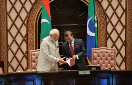 June 8, 2019, People's Majilis, Male' City: Indian Prime Minister Narendra Modi is gifted a copy of the first Constitution of the Maldives by Parliament Speaker Mohamed Nasheed. PHOTO: HUSSAIN WAHEED/MIHAARU