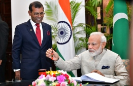 June 8, 2019, People's Majilis, Male' City: Indian Prime Minister Narendra Modi signs the guest book after he arrives to address the Maldivian parliament. PHOTO: HUSSAIN WAHEED/MIHAARU