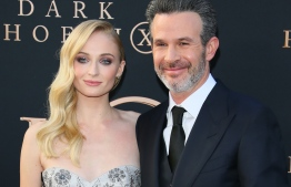 """English actress Sophie Turner and director and writer Simon Kinberg arrive for the """"Dark Phoenix"""" premiere at the TCL Chinese theatre IMAX in Hollywood on June 4, 2019. (Photo by Jean-Baptiste LACROIX / AFP)"""