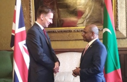 Minister Abdulla Shahid (R) discussed Maldives rejoining Commonwealth and the issue of climate change with the UK Foreign Secretary Jeremy Hunt. PHOTO: FOREIGN MV