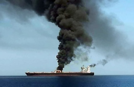 "A picture obtained by AFP from Iranian State TV IRIB on June 13, 2019 reportedly shows smoke billowing from a tanker said to have been attacked off the coast of Oman, at un undisclosed location. - The crews of two oil tankers were evacuated off the coast of Iran today after they were reportedly attacked and caught fire in the Gulf of Oman, sending world oil prices soaring. The mystery incident, the second involving shipping in the strategic sea lane in only a few weeks, came amid spiralling tensions between Tehran and Washington, which has pointed the finger at Iran over tanker attacks in May. Iran said its navy had rescued 44 crew members after the two vessels caught fire in ""accidents"" off its coast. (Photo by HO / IRIB TV / AFP) / == RESTRICTED TO EDITORIAL USE - MANDATORY CREDIT ""AFP PHOTO / HO / IRIB"" - NO MARKETING NO ADVERTISING CAMPAIGNS - DISTRIBUTED AS A SERVICE TO CLIENTS FROM ALTERNATIVE SOURCES, AFP IS NOT RESPONSIBLE FOR ANY DIGITAL ALTERATIONS TO THE PICTURE'S EDITORIAL CONTENT, DATE AND LOCATION WHICH CANNOT BE INDEPENDENTLY VERIFIED - NO RESALE -NO ACCESS lSRAEL MEDIA -PERSIAN LANGUAGE TV STATIONS OUTSIDE IRAN - STRICTLY NO ACCESS BBC PERSIAN  == /"