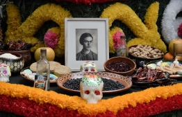 "(FILES) This file picture taken on October 31, 2017 shows a detail of an altar dedicated to Mexican artist Frida Kahlo at the Frida Kahlo Museum in Mexico City. - Cultural authorities in Mexico said on June 12, 2019 that they believe -though not 100 percent sure- they have found the first recording of the iconic painter Frida Kahlo (1907-1954) reading a text she wrote in 1949 for her husband, muralist Diego Rivera. Culture Minister Alejandra Frausto said the discovery of the recording is part of the collection of Alvaro ""El Bachiller"" Galvez y Fuentes, an important figure of the ""Golden Age"" of Mexican radio. (Photo by Yuri CORTEZ / AFP)"