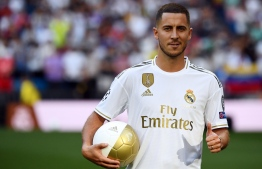 Belgian footballer Eden Hazard gives a thumbs-up during his official presentation as new player of the Real Madrid CF at the Santiago Bernabeu stadium in Madrid on June 13, 2019. PHOTO: GABRIEL BOUYS / AFP
