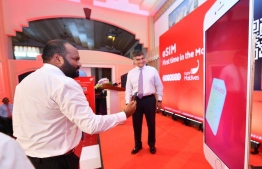 Minister of Tourism Ali Waheed (L) and Ooredoo Maldives' CEO Najib Khan launch eSIM services in the Maldives. PHOTO/OOREDOO