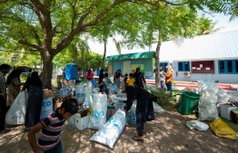 Parents and kids bring recyclable waste for the 'Zero Waste Challenge' at Maalhos School. PHOTO: SONEVA FUSHI