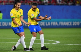 Brazil's forward Marta (R) celebrates with Brazil's midfielder Thaisa after scoring a goal during the France 2019 Women's World Cup Group C football match between Italy and Brazil, on June 18, 2019, at the Hainaut Stadium in Valenciennes, northern France. (Photo by Philippe HUGUEN / AFP)