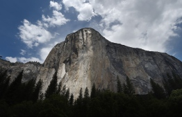 "(FILES) In this file photo taken on June 03, 2015 the El Capitan is seen in the Yosemite National Park in California. - A 10-year-old US girl has made rock climbing history by becoming the youngest person to ever scale Yosemite's iconic El Capitan. Selah Schneiter, of Colorado, scaled the nearly 3,000-foot (900-meter) ""The Nose"" route with her father, an experienced climber, and a family friend, over five days -- and celebrated her feat on June 12 with a pizza. (Photo by Mark RALSTON / AFP)"