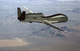 "This undated US Air Force file photo released on June 20, 2019 shows a photo of a RQ-4 Global Hawk unmanned surveillance and reconnaissance aircraft. - A US spy drone was some 34 kilometers (21 miles) from the nearest point in Iran when it was shot down over the Strait of Hormuz by an Iranian surface-to-air missile June 20, 2019, a US general said. ""This dangerous and escalatory attack was irresponsible and occurred in the vicinity of established air corridors between Dubai, UAE, and Oman, possibly endangering innocent civilians,"" said Lieutenant General Joseph Guastella, who commands US air forces in the region.""At the time of the intercept the RQ-4 was at high altitude, approximately 34 kilometers from the nearest point of land on the Iranian coast,"" he said, over a video to the Pentagon press briefing room. (Photo by Handout / US AIR FORCE / AFP) /"
