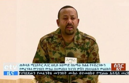 "In this handout videograb released by the Ethiopian TV broadcast, Ethiopia's Prime Minister Abiy Ahmed addresses the public on television on June 23, 2019 after a failed coup. - Ethiopia's army chief and the president of a key region have been shot dead in a wave of violence highlighting the political instability in the country as Prime Minister Abiy Ahmed tries to push through reforms. (Photo by HO / Ethiopian TV / AFP) / RESTRICTED TO EDITORIAL USE - MANDATORY CREDIT ""AFP PHOTO / Ethiopian TV / BYLINE"" - NO MARKETING NO ADVERTISING CAMPAIGNS - DISTRIBUTED AS A SERVICE TO CLIENTS --- NO ARCHIVE ---"