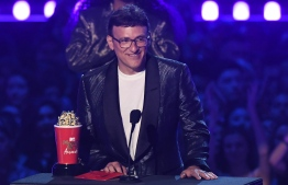"US director Anthony Russo accepts the award for Best Movie for ""Avengers: Endgame"" onstage during the 2019 MTV Movie & TV Awards at the Barker Hangar in Santa Monica on June 15, 2019. - The 2019 MTV Movie & TV Awards were filmed on June 15 and air on June 17. (Photo by VALERIE MACON / AFP)"