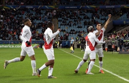 Peru's Yoshimar Yotun (R) celebrates with teammates after scoring against Chile during their Copa America football tournament semi-final match at the Gremio Arena in Porto Alegre, Brazil, on July 3, 2019. (Photo by Juan MABROMATA / AFP)