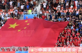 China's supporters deploy a giant Chinese flag ahead ofg the France 2019 Women's World Cup round of sixteen football match between Italy and China, on June 25, 2019, at La Mosson stadium in Montpellier, south western France. (Photo by Boris HORVAT / AFP)