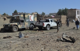 Afghan security personnel arrive at the site of a car bomb attack that targeted an intelligence unit in Ghazni on July 7, 2019. - A Taliban car bomb in eastern Afghanistan killed at least five people and wounded scores more on July 7, 2019, Afghan officials said, in a blast that came amid ongoing peace talks in Qatar. (Photo by STR / AFP)