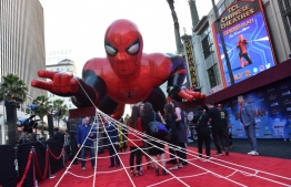 """(FILES) In this file photo taken on June 26, 2019 a giant inflatable Spider-Man is displayed on the red carpet for the """"Spider-Man: Far From Home"""" World premiere at the TCL Chinese theatre in Hollywood. Once again Spider-Man seems to be trapping everything that flies by: """"Spider-Man: Far From Home"""" took in an impressive $93.6 million in North America over the US holiday weekend and has passed the half-billion-dollar mark worldwide, industry watcher Exhibitor Relations estimated on July 7, 2019. This latest in the Spider-Man franchise, made by Sony and Disney-owned Marvel, set a record six-day total for a Tuesday release of $185.1 million, according to the Hollywood Reporter.  Chris Delmas / AFP"""