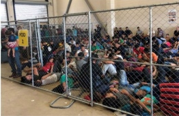 "This image released in a report on July 02, 2019 by the US Department of Homeland Security (DHS) Inspector General Office (OIG) shows migrant families overcrowding a Border Patrol facility on June 10, 2019 in McAllen, texas. - The report by the DHS inspector general said the health and security of both migrants and US Customs and Border Protection (CBP) officials is under threat ""We are concerned that overcrowding and prolonged detention represent an immediate risk to the health and safety of DHS agents and officers, and to those detained. "" (Photo by - / DHS/ Office of the Inspector General / AFP) /"