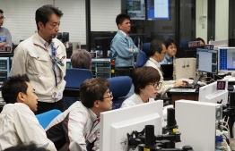 "In this handout photograph taken and released by the Institute of Space and Astronautical Science (ISAS) of Japan Aerospace Exploration Agency (JAXA) on July 10, 2019, shows researchers and employees working at a control room for the Hayabusa2 mission in Sagamihara city, Kanagawa prefecture. - Japan's Hayabusa2 probe began descending on July 10 for its final touchdown on a distant asteroid, hoping to collect samples that could shed light on the evolution of the solar system. (Photo by Yutaka IIJIMA / ISAS-JAXA / AFP) / RESTRICTED TO EDITORIAL USE - MANDATORY CREDIT ""AFP PHOTO / ISAS-JAXA"" - NO MARKETING NO ADVERTISING CAMPAIGNS - DISTRIBUTED AS A SERVICE TO CLIENTS"