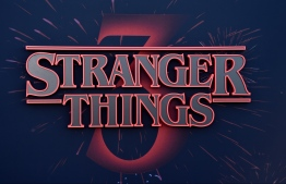 """(FILES) In this file photo taken on June 28, 2019, the Stranger Things logo seen on the backdrop of Netflix's """"Stranger Things 3"""" premiere at Santa Monica high school Barnum Hall  in Santa Monica, California. - Retro sci-fi mystery """"Stranger Things"""" has broken Netflix viewing records with the global launch of its third season, the streaming giant said in a rare tweet publishing viewing data. The nostalgic 1980s show about a gang of suburban adolescents battling supernatural monsters had been watched by 40.7 million accounts since July 4, 2019, it said. (Photo by Chris Delmas / AFP)"""