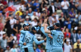 England's Adil Rashid celebrates with teammates the wicket of Australia's Alex Carey for 46 during the 2019 Cricket World Cup second semi-final between England and Australia at Edgbaston in Birmingham, central England,  on July 11, 2019. (Photo by Paul ELLIS / AFP) /