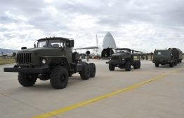 """A handout photograph taken and released on July 12, 2019, by the Turkish Defence Ministry shows a Russian military cargo plane, carrying S-400 missile defence system from Russia, during its unloading at the Murted military airbase (also known as Akincilar millitary airbase), in Ankara. - The delivery to an air base in Ankara comes after Washington warned this week that there would be """"real and negative"""" consequences if Turkey bought the defence system. NATO, which counts Turkey as one of its members, has repeatedly warned Turkey that the Russian system is incompatible with other NATO weapons systems, not least the F-35, a new generation multi-role stealth fighter jet. (Photo by TURKISH DEFENCE MINISTERY PRESS / TURKISH DEFENCE MINISTRY / AFP) / RESTRICTED TO EDITORIAL USE - MANDATORY CREDIT """"AFP PHOTO / TURKISH DEFENCE MINISTRY""""- NO MARKETING NO ADVERTISING CAMPAIGNS - DISTRIBUTED AS A SERVICE TO CLIENTS"""