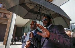 (FILES) In this file photo taken on June 26, 2019 R. Kelly leaves the Leighton Criminal Court Building after a hearing on sexual abuse charges in Chicago, Illinois. - R&B superstar R. Kelly has been arrested on suspicion of having sex with five underage girls, recording some of it on video tapes, and then attempting to hide the evidence, US prosecutors said on July 12, 2019. (Photo by KAMIL KRZACZYNSKI / AFP)
