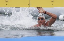 This handout photo taken and released by the FINA Organising Committee via Yonhap shows Hungary's Kristof Rasovszky competing in the men's 5km open water swimming final during the 2019 World Championships in Yeosu on July 13, 2019. (Photo by Handout / FINA Organising Committee via Yonhap / AFP) /