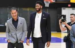 Los Angeles Lakers NBA basketball team general manager Rob Pelinka (L) walks with forward Anthony Davis (R) as he is introduced by his new team, the Los Angeles Lakers at his press event in El Segundo, California on July 13, 2019. - The Los Angeles Lakers acquired Anthony Davis from the New Orleans Pelicans. (Photo by Mark RALSTON / AFP)
