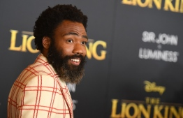 """US actor Donald Glover arrives for the world premiere of Disney's """"The Lion King"""" at the Dolby theatre on July 9, 2019 in Hollywood. (Photo by Robyn Beck / AFP)"""