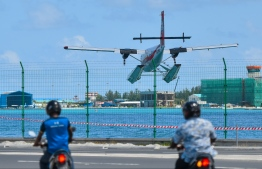 A seaplane flies over Hulhumale to land in the lagoon of VIA. PHOTO: HUSSAIN RASHEED / MIHHARU