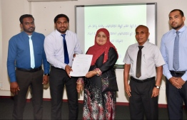 Members of the Elections Commission presenting Saeedha Rasheed with written permission to form the Sunrise Party. PHOTO: ELECTIONS COMMISSION (EC)