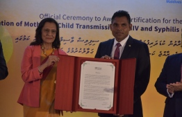 Vice President Faisal Naseem accepting certification that Maldives is free of perinatal transmission of HIV and syphilis. PHOTO: MINISTRY OF HEALTH