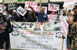 Victims of the Sea Life Global housing scam protests in front of Housing Development Corporation (HDC). PHOTO: MIHAARU