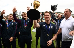 England's Jason Roy (L), England's Liam Plunkett (2L), England's Joe Root (3L) and England's captain Eoin Morgan attend a World Cup victory event at The Oval in London on July 15, 2019, a day after they won the 2019 Cricket World Cup final against New Zealand. - England won the World Cup for the first time ever on Sunday, holding their nerve to seal a thrilling Super Over victory against New Zealand after the final ended in a tie. Eoin Morgan's side finished on 241 all out in pursuit of New Zealand's 241-8, sending the match at Lord's to a six-ball shootout for each side. (Photo by Daniel LEAL-OLIVAS / AFP) /
