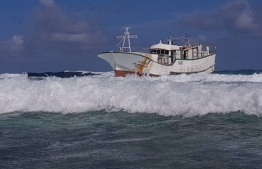 A local fishing trawler run aground a reef. FILE PHOTO/MIHAARU