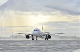 An aircraft of Maldivian lands at Velana International Airport. FILE PHOTO: HUSSAIN WAHEED / MIHAARU