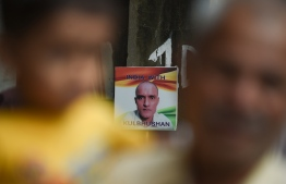 A placard depicting Kulbhushan Jadhav, an Indian national convicted of spying in Pakistan, is pictured in the neighborhood where he grew up, in Mumbai on July 17, 2019. - The International Court of Justice will decide on July 17 on India's bid to remove an alleged spy from death row in Pakistan, in a case that has stoked tensions between the South Asian rivals. (Photo by Indranil MUKHERJEE / AFP)
