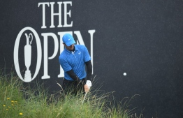 Northern Ireland's Rory McIlroy chips onto the 18th green during the first round of the British Open golf Championships at Royal Portrush golf club in Northern Ireland on July 18, 2019. (Photo by Glyn KIRK / AFP) /