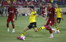 Borussia Dortmund midfielder Nico Schulz (C) kicks the ball against Liverpool during the second half of the international friendly match at Notre Dame Stadium in South Bend, Indiana, July 19, 2019. (Photo by KAMIL KRZACZYNSKI / AFP)