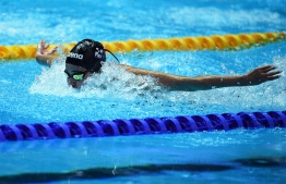 Syrian refugee Yusra Mardini competes in a heat for the women's 100m butterfly event during the swimming competition at the 2019 World Championships at Nambu University Municipal Aquatics Center in Gwangju, South Korea, on July 21, 2019. (Photo by Oli SCARFF / AFP)