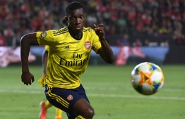 Forward Eddie Nketiah of Arsenal chases the ball against Bayern Munich during their International Champions Cup game at the Dignity Health Stadium in Carson, California on July 17, 2019. - Arsenal went on to win 2-1. (Photo by Mark RALSTON / AFP)