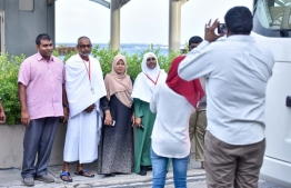 Locals snapping pictures at the airport before departing for the 2019 pilgrimage. Ministry of Foreign Affairs announced that special teams from the embassy will be aiding pilgrims this year. PHOTO: MIHAARU FIILES