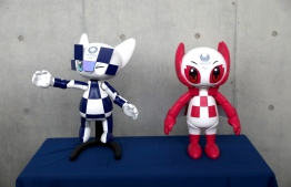 Robotic versions of Miraitowa (L) and Someity, respective mascots of the Tokyo 2020 Olympic and Paralympic Games, are displayed during an unveiling ceremony marking one year before the start of the games at Ajinomoto stadium in Tokyo on July 22, 2019. - A roster of Olympic robots that will do everything from welcoming visitors to transporting javelins has been unveiled as Tokyo works to showcase Japanese technology at next year's Summer Games. (Photo by Behrouz MEHRI / AFP)